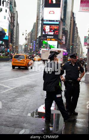 NYPD police officers in Times Square, New York city, Manhattan patrolling the streets looking for trouble Times - Stock Photo
