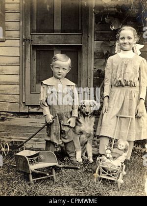 Little Brother & Big Sister with Toys & Dog - Stock Photo
