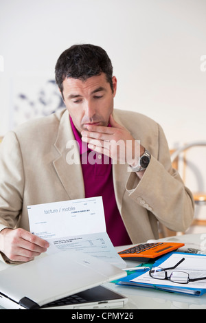 MAN FILLING OUT FORMS - Stock Photo