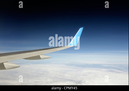 wing of thomson boeing 757-200 aeroplane in flight at 36000 feet - Stock Photo