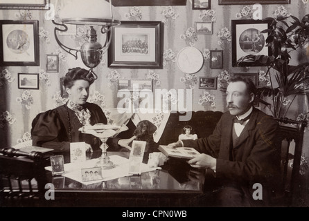 Proper Victorian Couple in Parlor with their Dachshund - Stock Photo