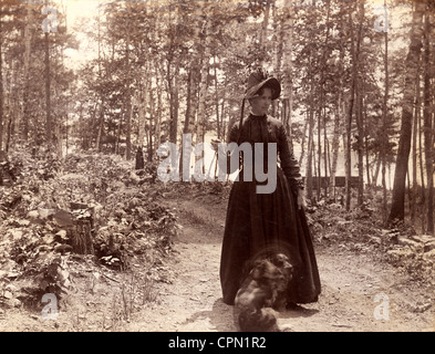 Victorian Woman Taking Dog for a Walk in the Woods