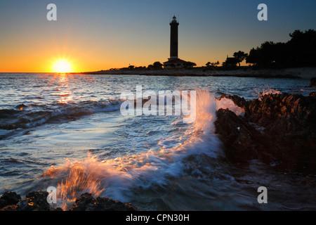 Sunset at Veli rat on 'Dugi otok', Croatia. Waves splashing rocks on the beach. - Stock Photo