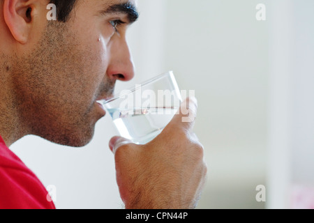 MAN WITH COLD DRINK - Stock Photo