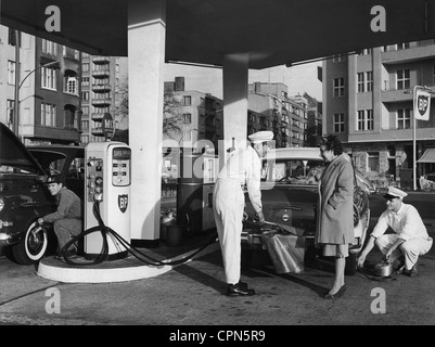 transport / transportation, car, petrol station, BP petrol station, filling station attendant is helping customer - Stock Photo