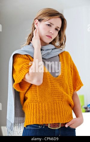 EAR PAIN IN A WOMAN - Stock Photo