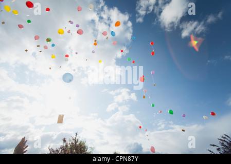 Balloons floating toward sky - Stock Photo
