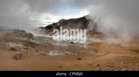 Iceland, Namafjall, fumaroles and mudpots releasing steam and sulfur gas - Stock Photo