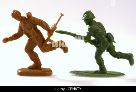 toys, military toys, symbol, fight against the terrorism, soldier with rifle, one centimeter plastic figures from - Stock Photo
