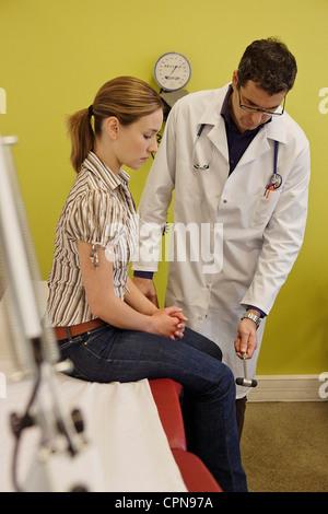 REFLEX SYMPTOMATOLOGY WOMAN - Stock Photo