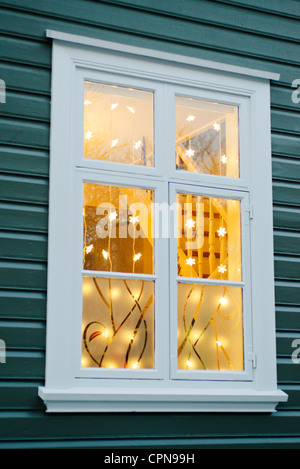 Christmas lights hanging in widow - Stock Photo