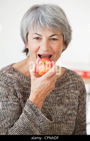 ELDERLY PERSON EATING FRUIT - Stock Photo