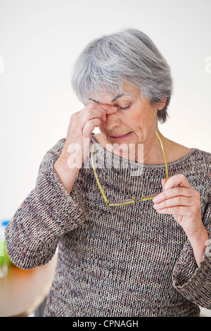 TIRED ELDERLY PERSON - Stock Photo
