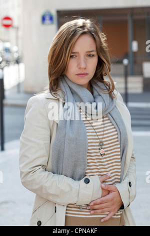 ABDOMINAL PAIN IN A WOMAN - Stock Photo
