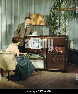 broadcast, television, viewers, married couple is watching television, television console Clivia FER 858, made by: - Stock Photo