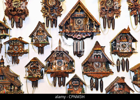 clock, cuckoo clock, Black Forest cuckoo clocks, hanging on the wall, selection in a Munich souvenir shop, Germany, - Stock Photo