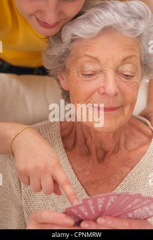 ELDERLY P. PLAYING A GAME - Stock Photo