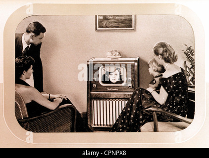 broadcast, television, Telefunken television set FE 8 S, one of the first German postwar receiver, family in front - Stock Photo