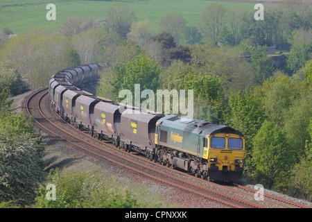 Freightliner 66506 mainline diesel locomotive train near Low Baron Wood Farm Armathwaite Eden Valley, Cumbria, England, - Stock Photo