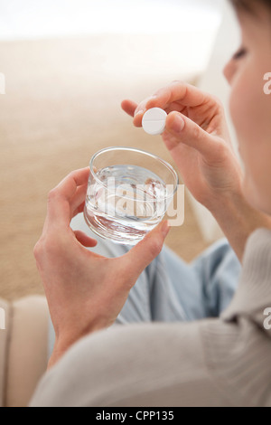 WOMAN TAKING MEDICATION - Stock Photo