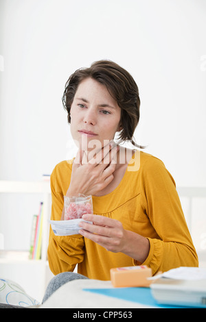 COUGHING TREATMENT WOMAN - Stock Photo
