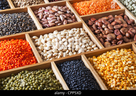 peas, beans and lentils in the wooden box - Stock Photo