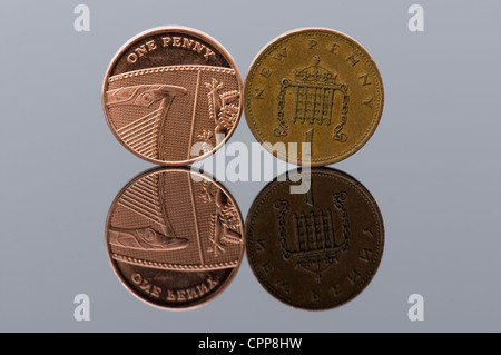 One new penny piece with the old style penny with reflection, concept every penny counts - Stock Photo
