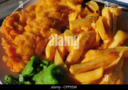 Fish and chips, and mushy peas - Stock Photo