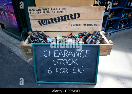 clearance stock sign on a Warbird box full of bottles of beer, Borough Market, London, England, UK - Stock Photo