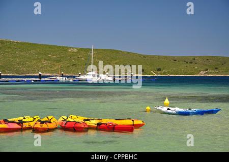 Hire kayaks in harbour, Fornells, Menorca, Balearic Islands, Spain - Stock Photo
