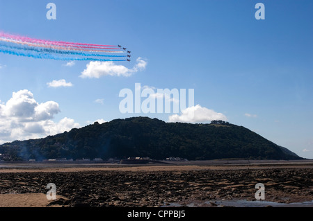 Red Arrows in formation over North Hill, Minehead, Somerset - Stock Photo