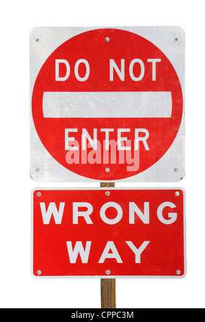do not enter wrong way red and white road sign isolated on white background - Stock Photo