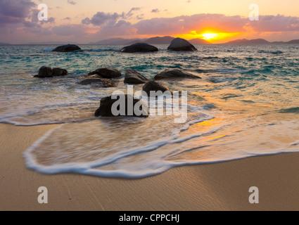Virgin Gorda, British Virgin Islands, Caribbean Boulders awash in the surf of Little Trunk Bay - Stock Photo