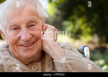 Senior Woman Smiling in Wheelchair - Stock Photo