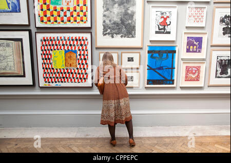 28/05/2012. Royal Academy of Arts Summer Exhibition, London, UK. Image shows various art works being viewed in Gallery - Stock Photo