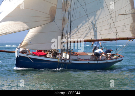 Old Gaffer tanned sail sailing in Yarmouth Festival Jubilee nostalgic Celebrations - Stock Photo