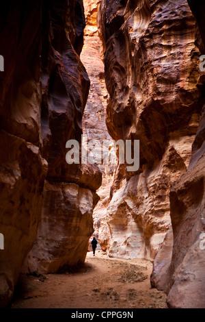 Lone tourist in (Al-Siq) The Siq, Wadi Musa, Petra, Jordan, Western Asia - Stock Photo