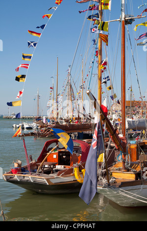 Yarmouth Old Gaffers Festival Jubilee nostalgic past history celebrations summer flags bunting - Stock Photo