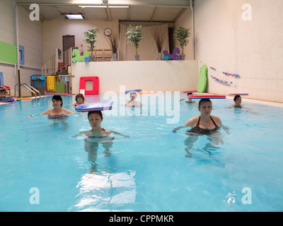 PREGNANT WO. EXERCISING IN WATER Stock Photo: 48442700