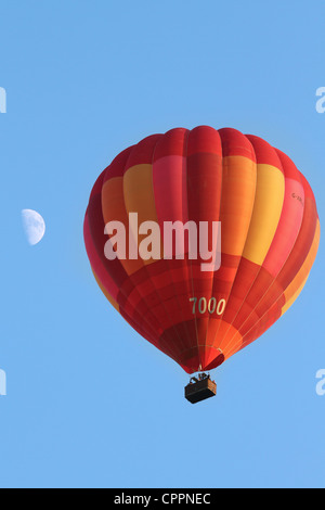 A Hot Air Balloon flies over the south west of England. - Stock Photo
