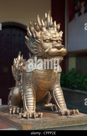 Bronze lion statue in front of building in Guilin China - Stock Photo