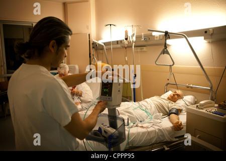 MAN RECEIVING BLOOD TRANSFUSION - Stock Photo