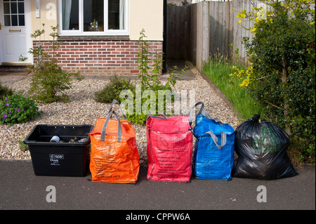Household waste and recycling awaiting kerbside collection by Cornwall Council contractors, sorted into coloured - Stock Photo