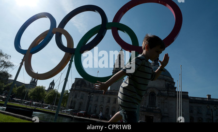 A young boy practising running near the Olympic Rings Cardiff Wales UK KATHY DEWITT - Stock Photo