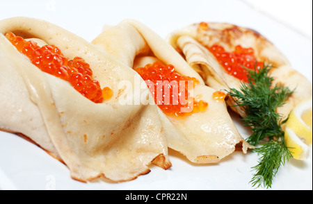 Hot pancakes with red caviar in the middle - Stock Photo