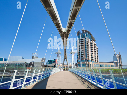 Millennium bridge, apartments and Lowry centre Salford Quays Manchester England UK GB EU Europe - Stock Photo