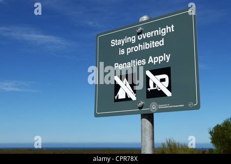 A sign cautions visitors that camping and overnight stays are not permitted within Nambung National Park in Western - Stock Photo