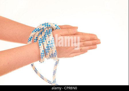 Hands tied with rope isolated on white background - Stock Photo
