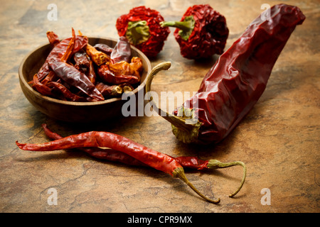 Assortment of dried chili peppers - Stock Photo