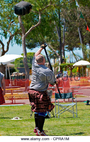 Sheaf toss at the Scottish Festival Costa Mesa California - Stock Photo